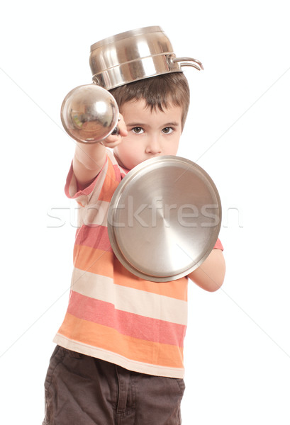 Little boy play knight with kitchen utensil Stock photo © pekour