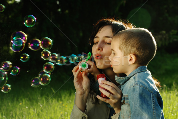 Mother and son making soap bubbles outdoors Stock photo © pekour
