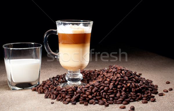 Cappuccino glass with coffee beans and glass of milk Stock photo © pekour