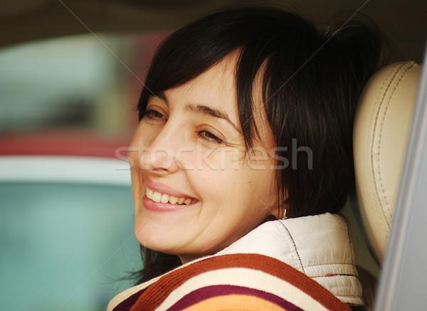 Güzel bir kadın araba güzel esmer kadın gülme Stok fotoğraf © pekour