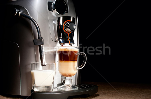 Coffee machine with milk glass and cappuccino Stock photo © pekour