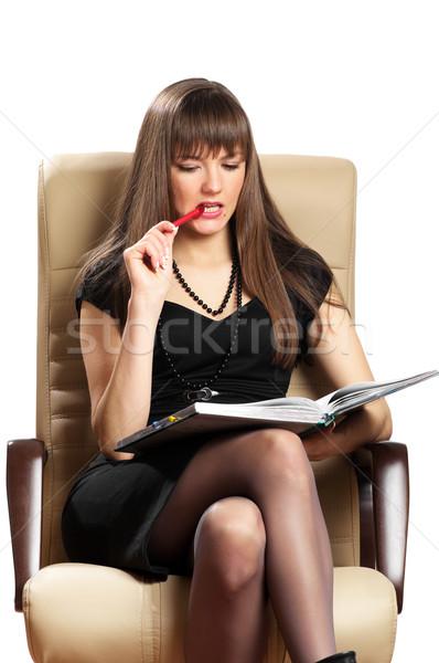 Güzel bir kadın yazı notlar oturma deri sandalye Stok fotoğraf © pekour
