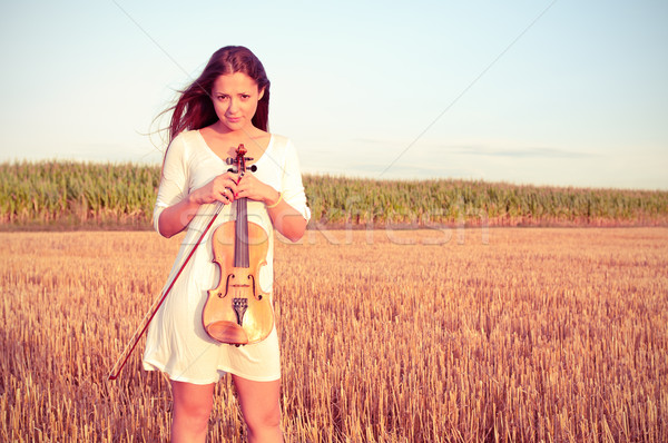 Young woman with violin outdoors Stock photo © pekour