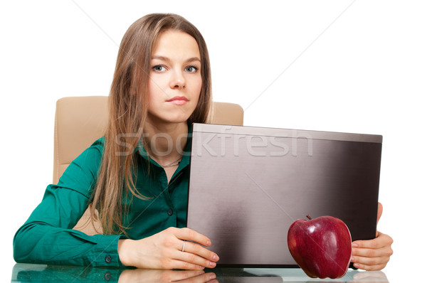Beautiful woman office worker with laptop and apple Stock photo © pekour