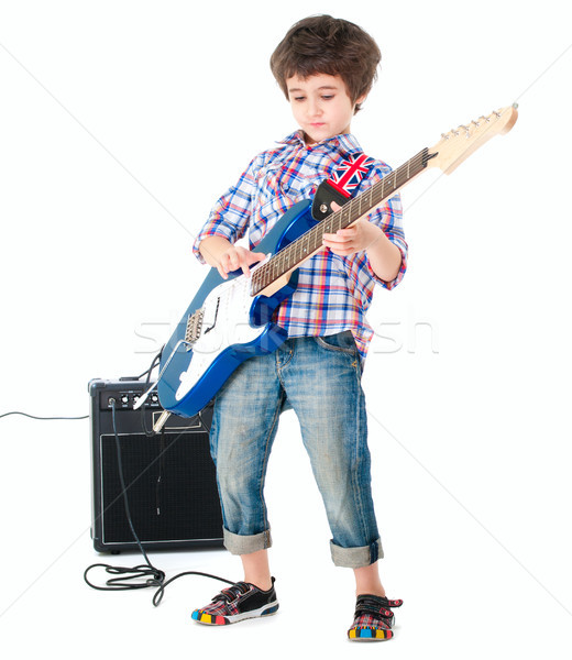 Little boy britpop style with electoguitar and guitar combo full Stock photo © pekour