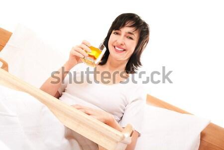 Feliz mulher cama suco de maçã isolado branco Foto stock © pekour