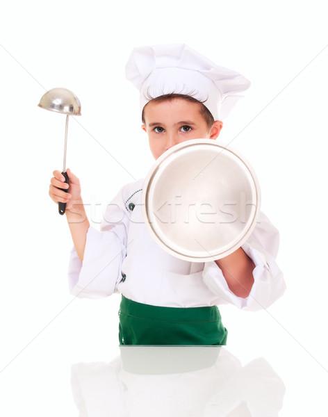 Little boy cook threaten with kitchen utensil Stock photo © pekour