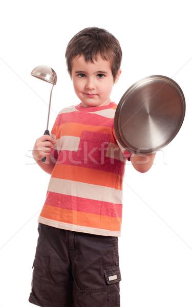 Little boy play knight with kitchen utensil Stock photo © pekour