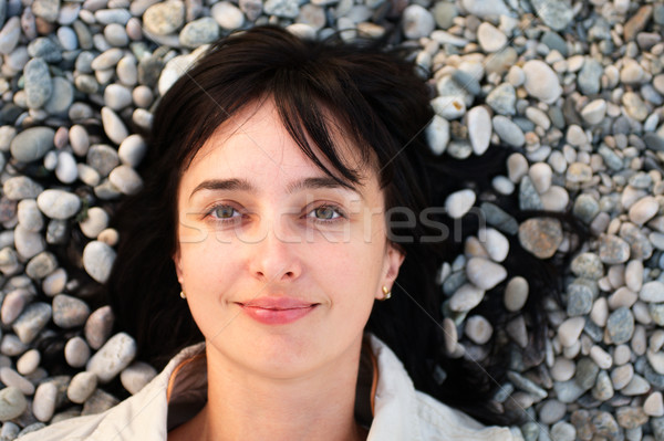 Kadın yalan taş plaj portre Stok fotoğraf © pekour