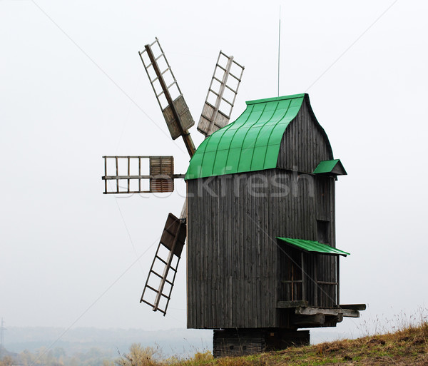 Old windmill with copper roof Stock photo © pekour