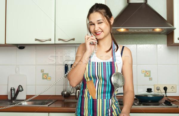 Housewife talking phone on the kitchen stock photo © Oleksandr ...
