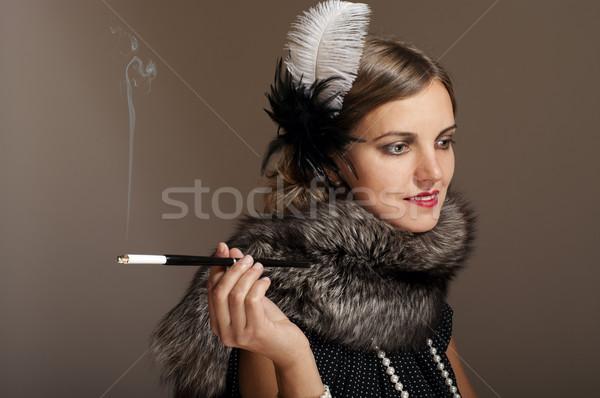 Retro mulher pele cigarro pena Foto stock © pekour