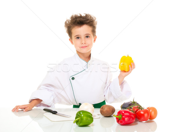 Little boy chef in uniform with knife cooking vegatables holding Stock photo © pekour