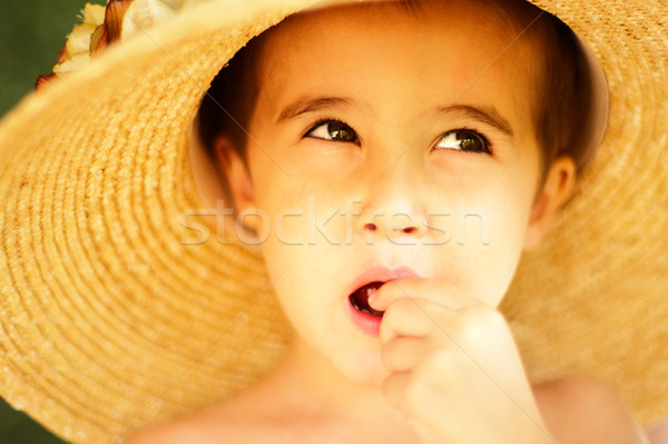 Naughty little boy in straw hat eats Stock photo © pekour