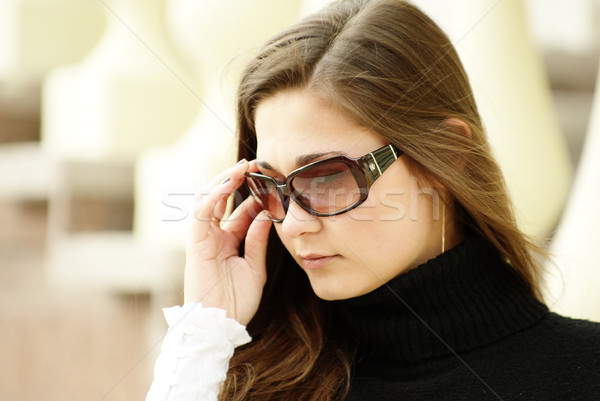 Yong girl in sunglasses by balustrade Stock photo © pekour