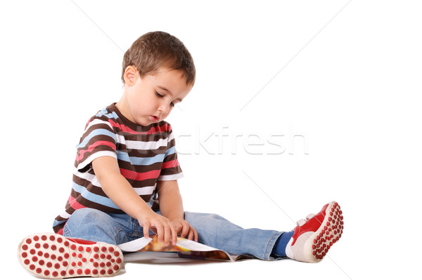 Erkek okuma dergi oturma zemin yalıtılmış Stok fotoğraf © pekour