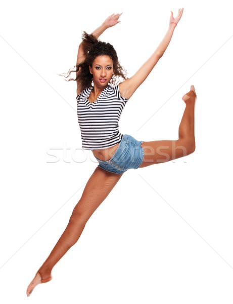 Saltando jovem isolado branco saltar jeans Foto stock © pekour