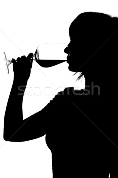 Silhouette femme potable vin rouge isolé blanche Photo stock © pekour