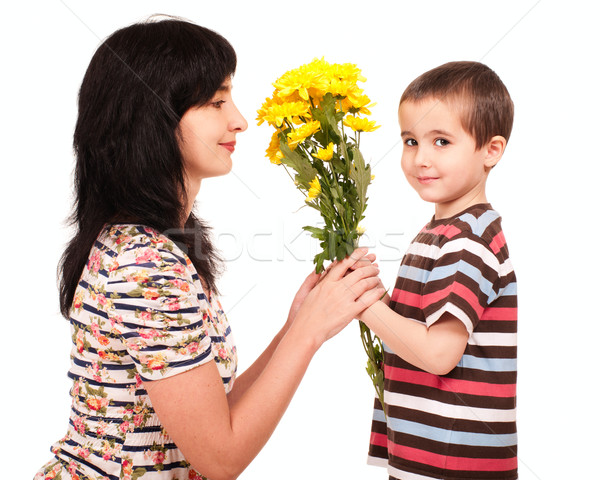 Little boy gives flowers to his mom Stock photo © pekour