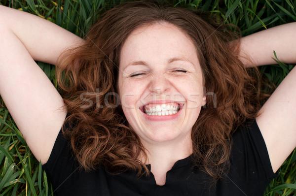Mujer riendo mentir hierba feliz Foto stock © pekour