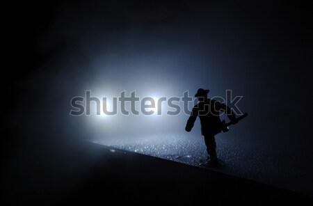 Firefighter run onto the car lights in the mist  Stock photo © pekour