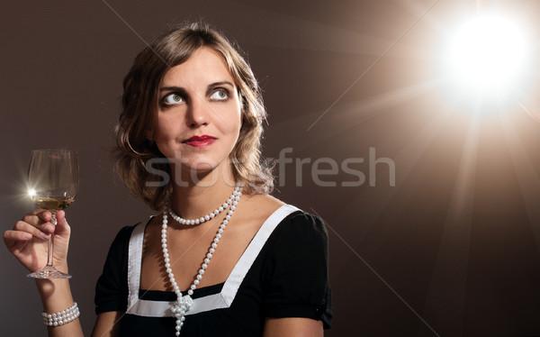 Güzel Retro kadın cam beyaz şarap parlama Stok fotoğraf © pekour
