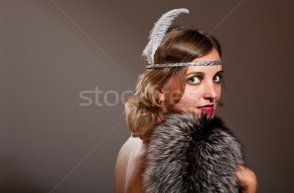 Retro woman with feather and fur Stock photo © pekour