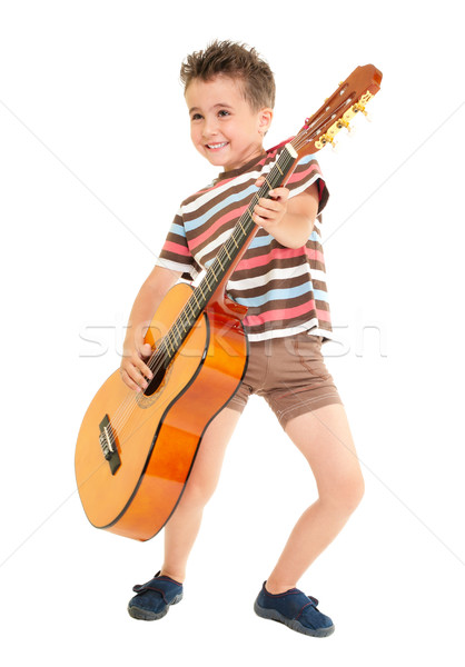 Little boy plays guitar country rock style Stock photo © pekour