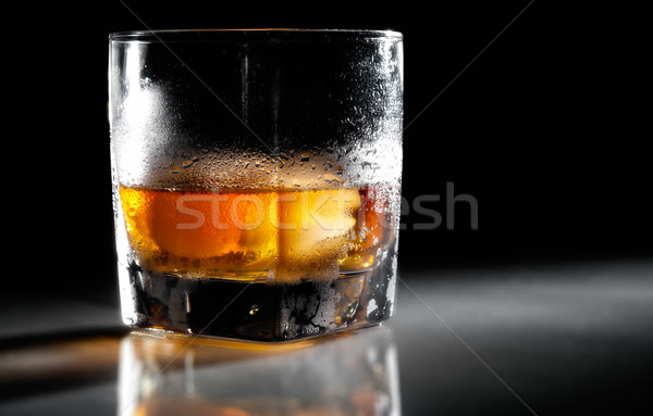 Closeup misted glass of whiskey in backlight Stock photo © pekour