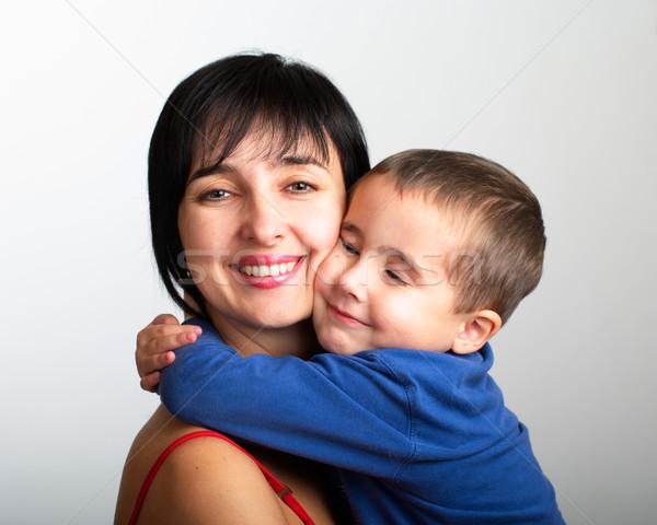 Anne oğul kucaklamak portre gri Stok fotoğraf © pekour