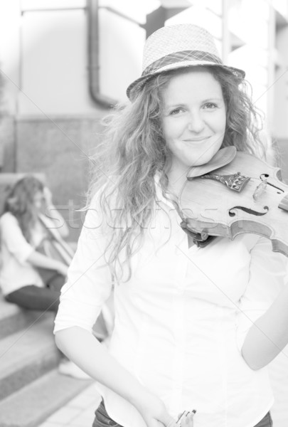 Woman from strings duet playing violin on the street Stock photo © pekour