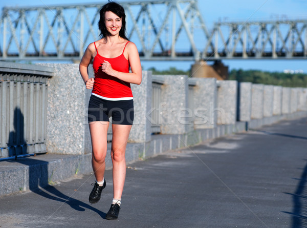 Woman jogging at the embankment  Stock photo © pekour