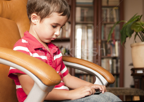 Küçük erkek oynamak oyun deri Stok fotoğraf © pekour