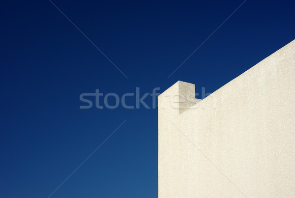 Sarı duvar mavi gökyüzü Stok fotoğraf © pekour