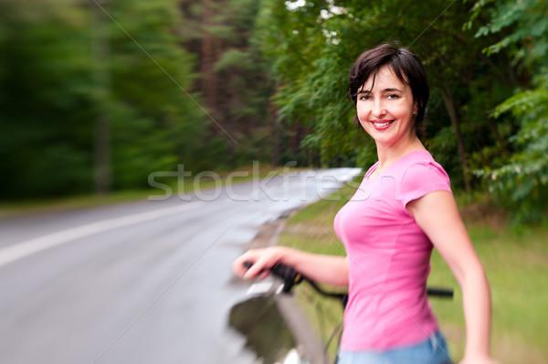 Mujer moto lluvioso forestales carretera efecto Foto stock © pekour