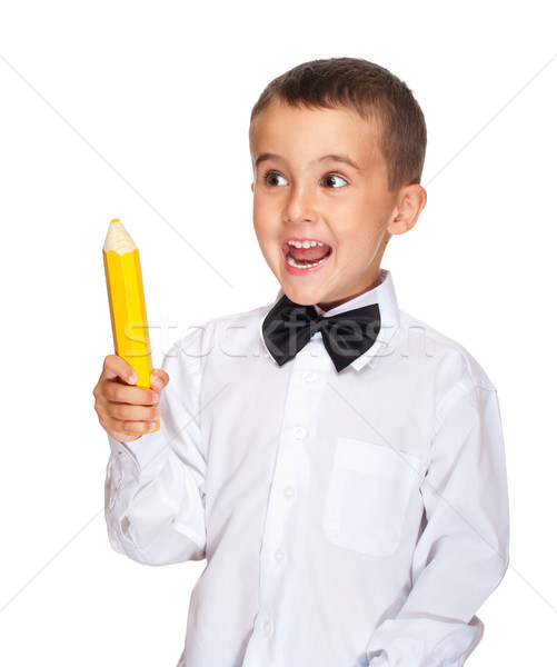 Happy elementary student boy with yellow pensil Stock photo © pekour