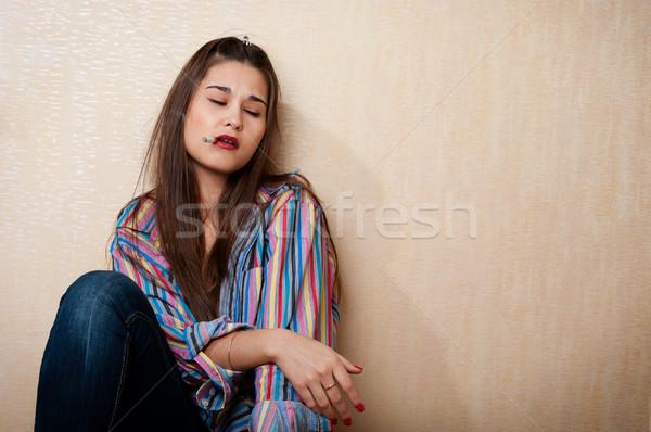 депрессия женщину сидят стены сигарету рот Сток-фото © pekour