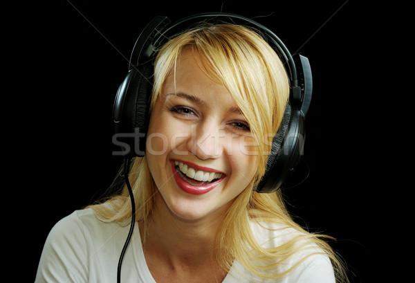 Gülme kız kulaklık yalıtılmış Stok fotoğraf © pekour
