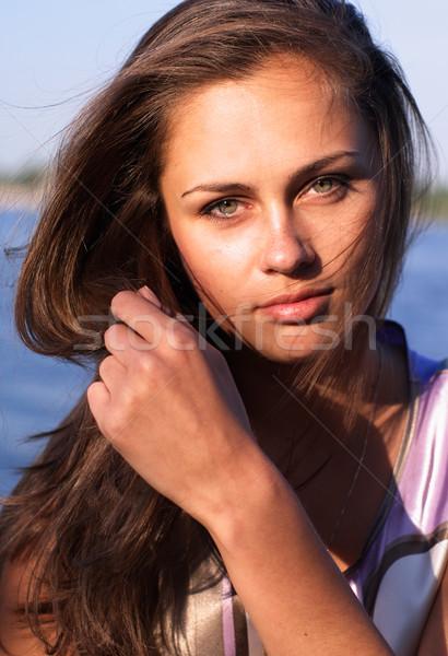 Gyönyörű lány hosszú haj folyó part megnyugtató lány Stock fotó © pekour