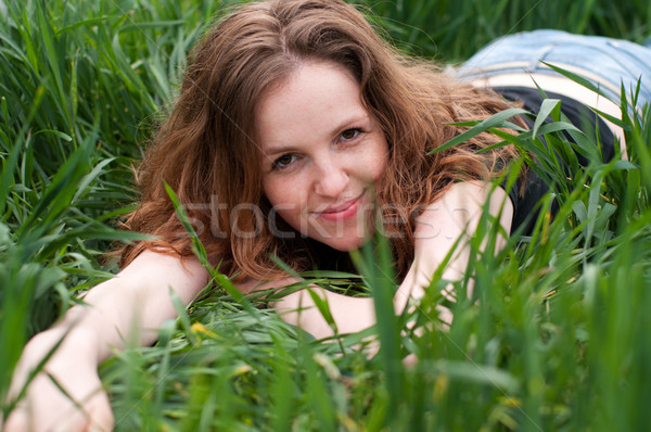 Beautiful girl ocultação grama verde belo menina Foto stock © pekour