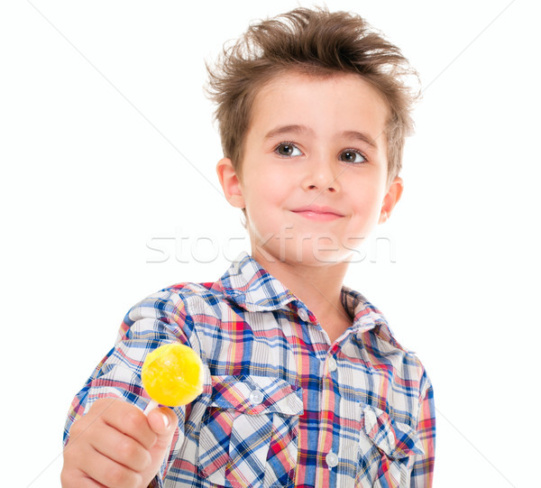 Little smiling serene boy with lollypop in hand Stock photo © pekour