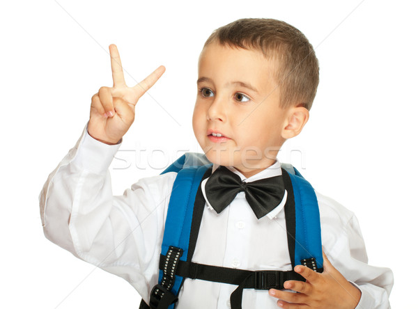 Portrait of elementary school boy showing victory sign Stock photo © pekour