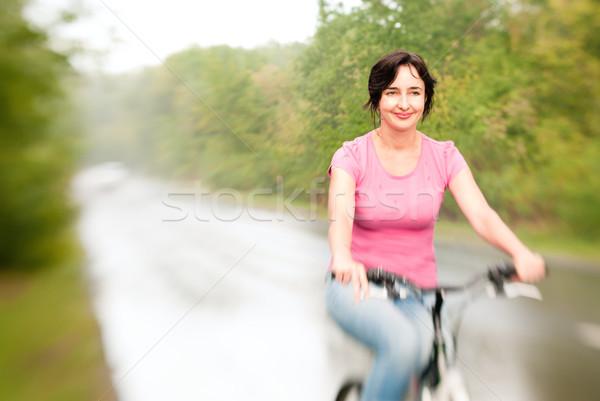 女性 ライディング 自転車 雨の 森林 道路 ストックフォト © pekour