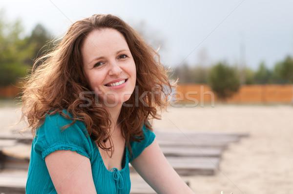 улыбаясь женщину улице пусто пляж Сток-фото © pekour