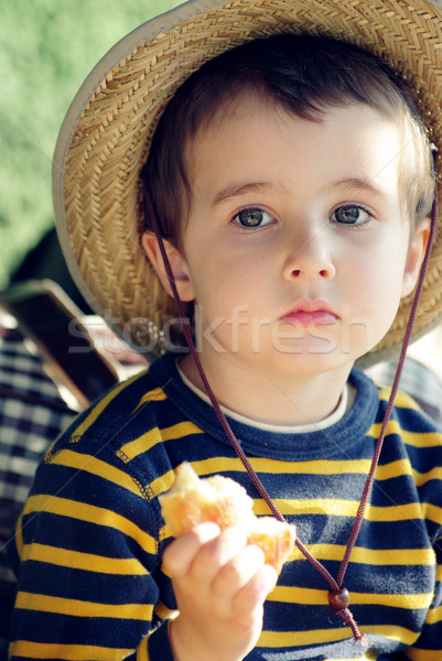 Small boy in straw hat daydreams  Stock photo © pekour