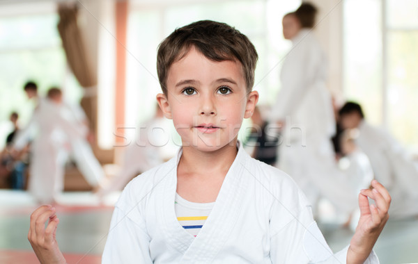 Little boy in kimono meditation before competition Stock photo © pekour