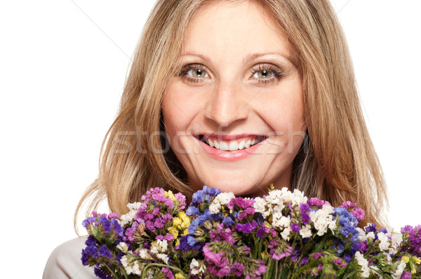 Gülen sarışın kadın buket alan çiçekler yalıtılmış Stok fotoğraf © pekour