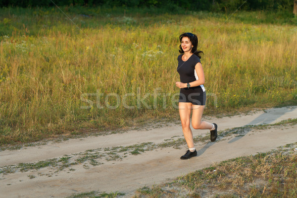 Woman jogging outdoors in forest road Stock photo © pekour