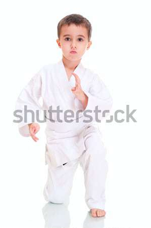 Aikido boy fighting position in white kimono Stock photo © pekour