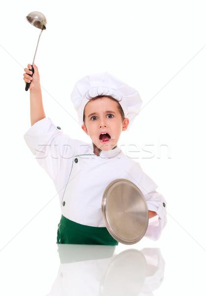 Weinig boos jongen kok geïsoleerd Stockfoto © pekour